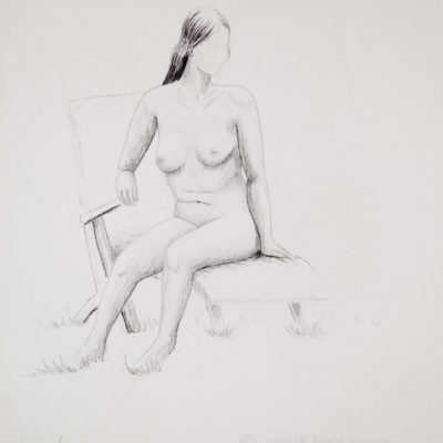A model on armchair looking left