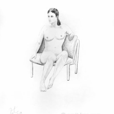 A model on armchair looking right