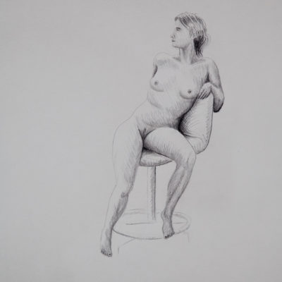 A nude model sitting on a turning-chair