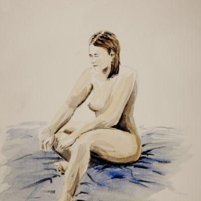 A nude model sitting on the floor
