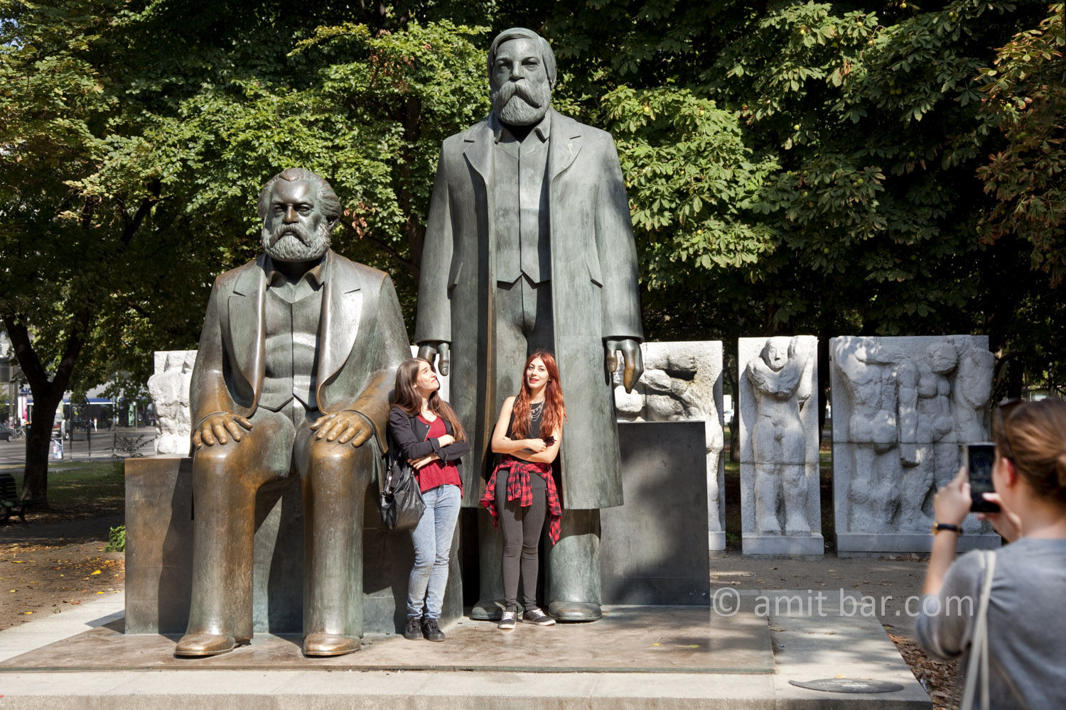 Berlin 2: The influence of Marx and Engels. Two girls beside the sculptures of Marx and Engels