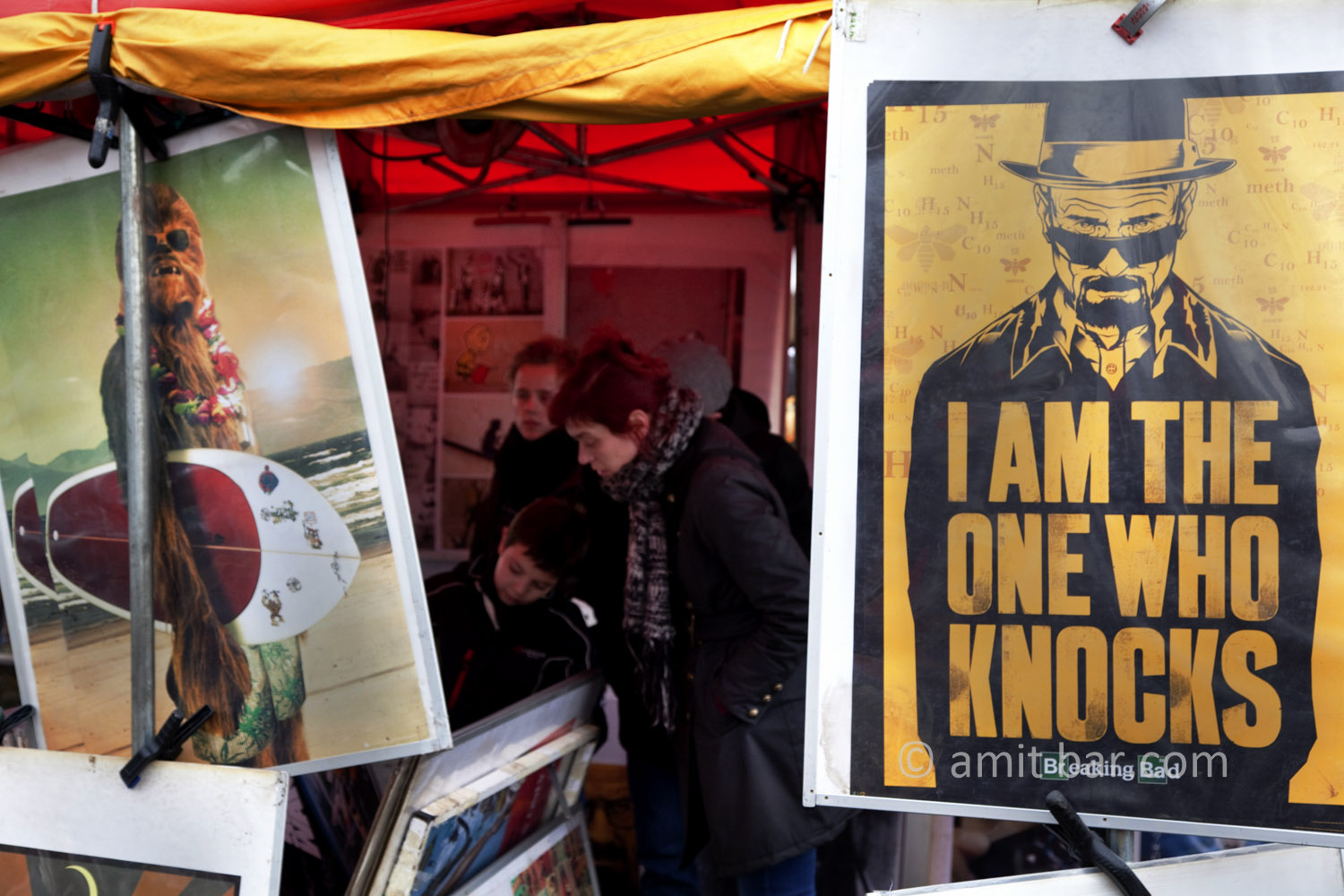 Berlin: I am the one. A boy is searching video film on the Sunday market.