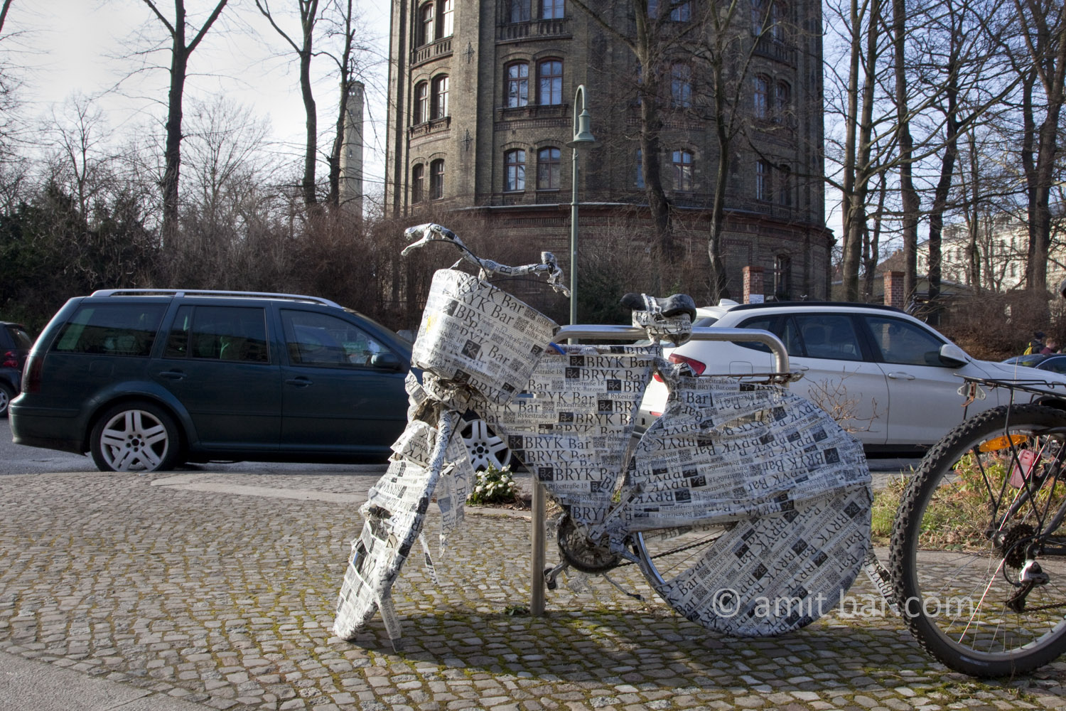 Berlin: Wrapped Bike are parked on street.