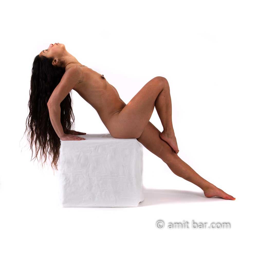 Black hair I: Black-haired model on a white box