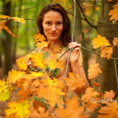 Body painted autumn leaves