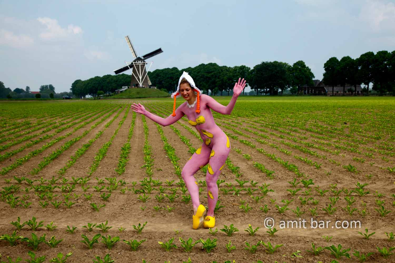 Clog dance II: Body-painted model dancing with Dutch wooden shoes near the windmill of Bronkhorst