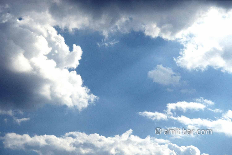 Clouds I: black and white clouds in blue sky