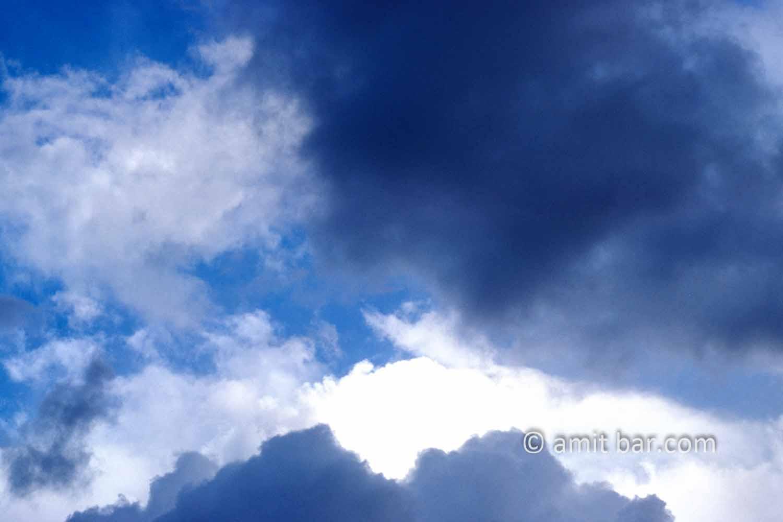 Clouds II: black and white clouds in blue sky