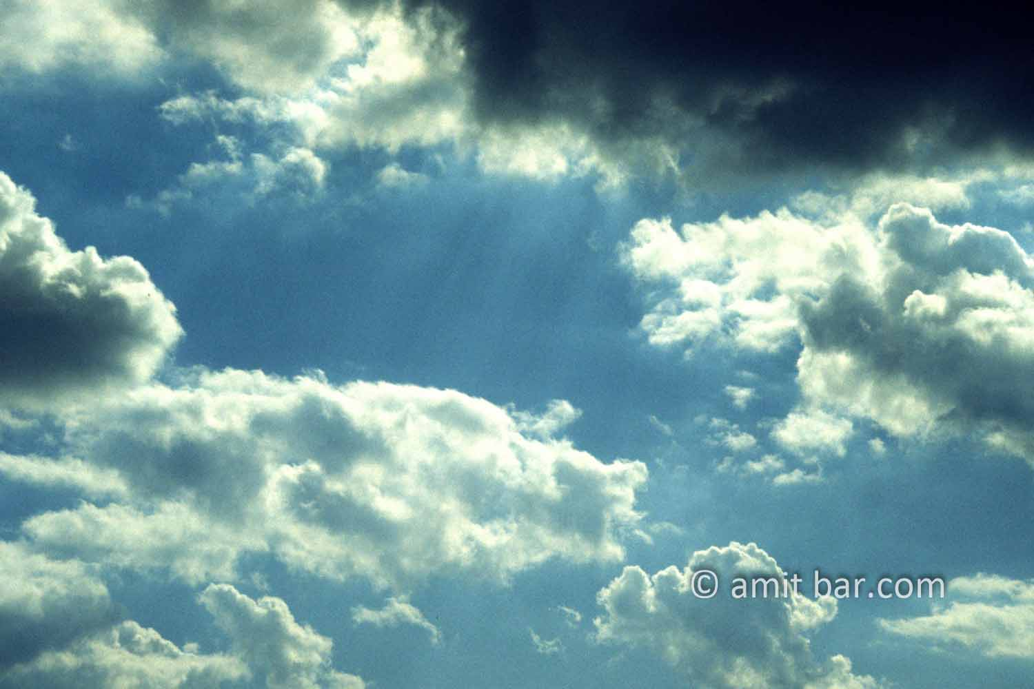 Clouds V: black and white clouds in blue sky