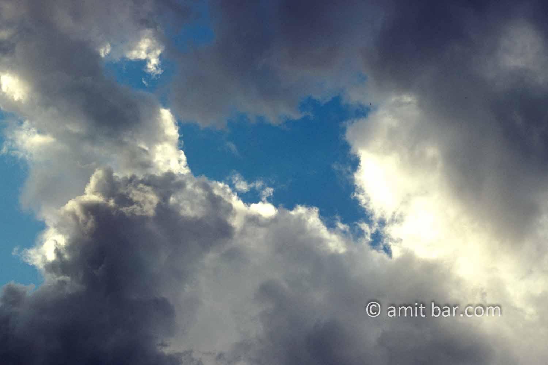 Clouds VI: black and white clouds in blue sky