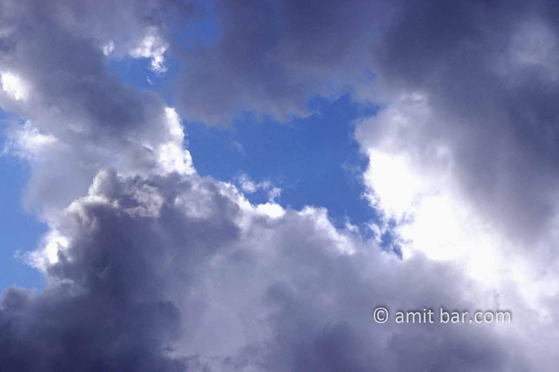 Clouds VIII: black and white clouds in blue sky