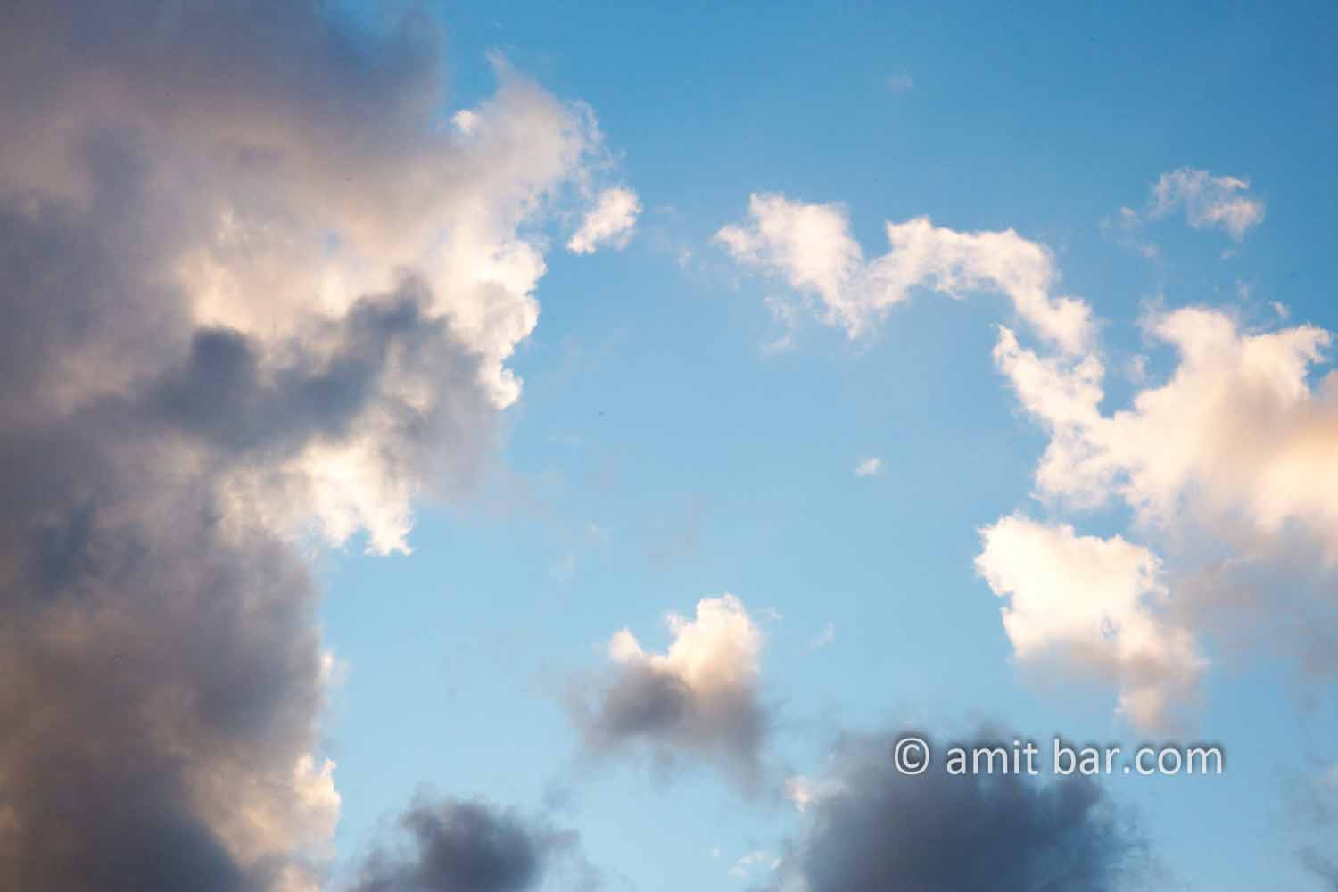 Clouds XII: black and white clouds in blue sky