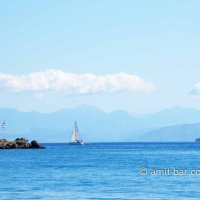 Corfu: Clouds, mountains and sailing boat