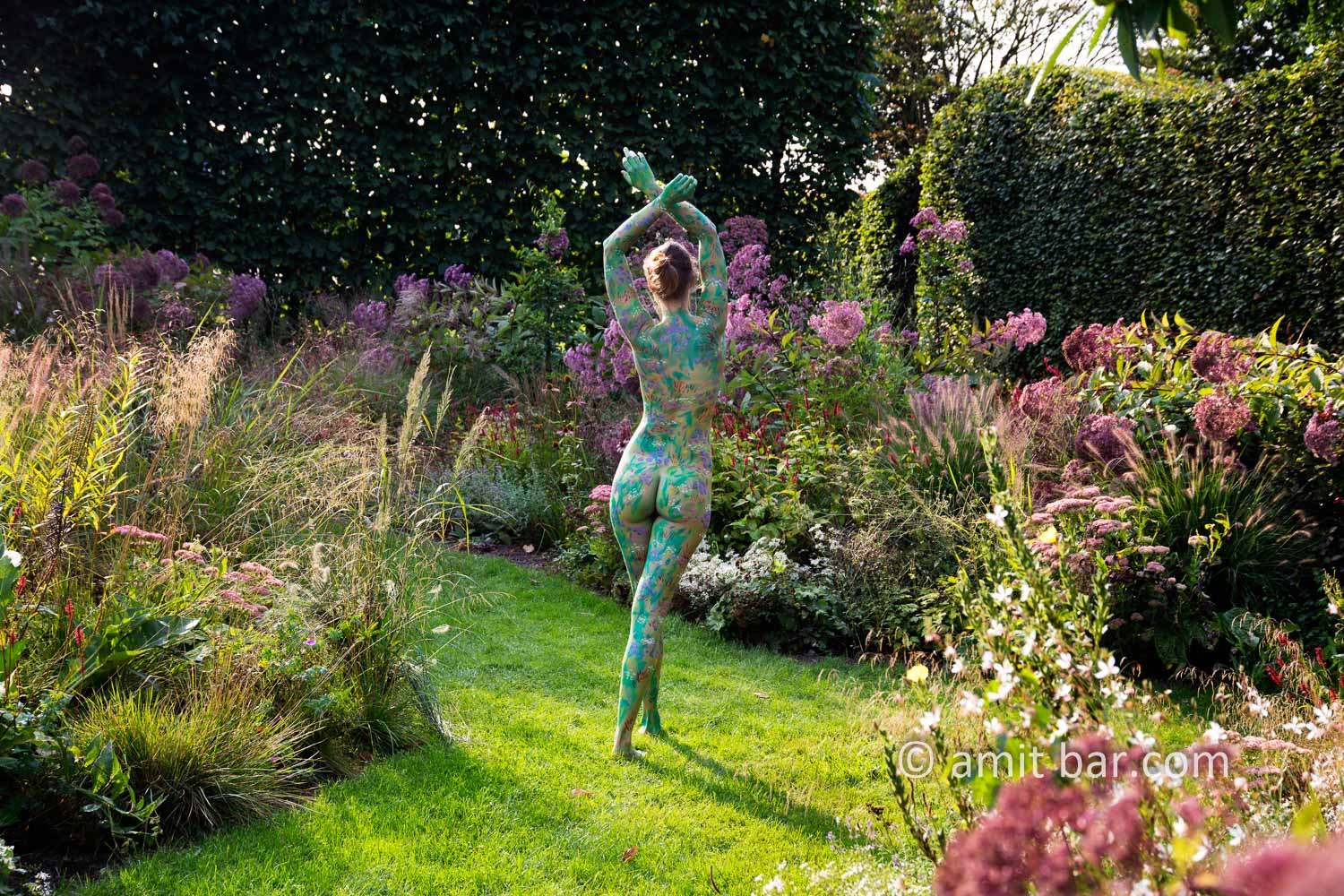 Garden flowers I: A body painted model is walking on a cloudy afternoon among the flowers of a beautiful garden in De Achterhoek, The Netherlands.