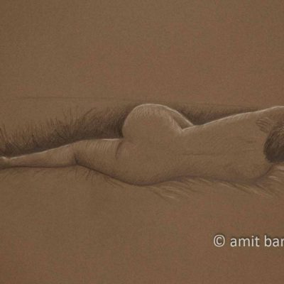 Lying nude model from her back on brown paper