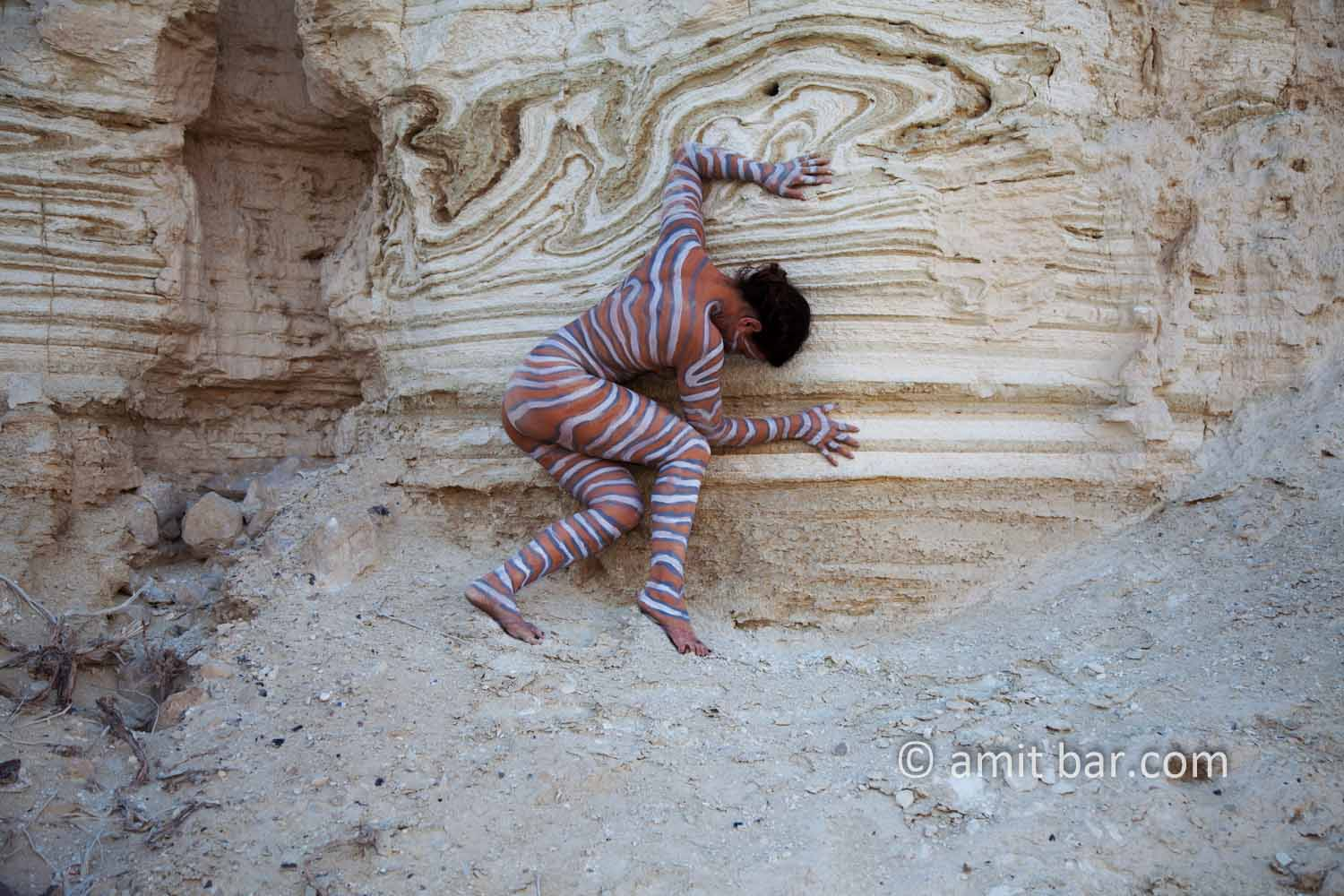 Nachal Prazim III: Body painted model at the desert of the Dead Sea, Israel.