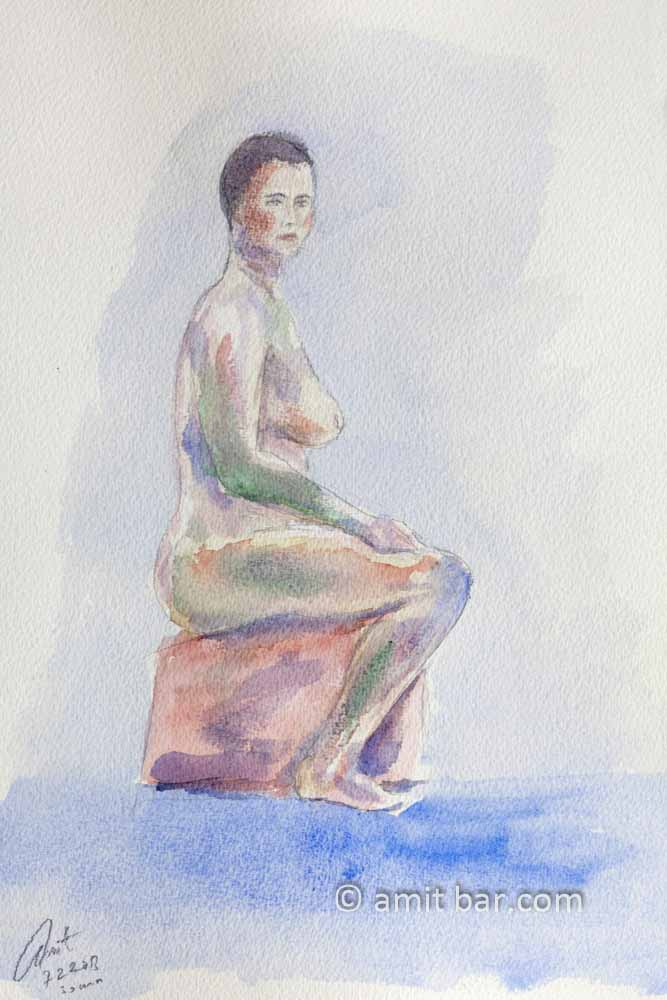 Nude model sitting on a block. Aquarel