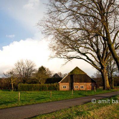 Rain clouds above farmhouse II
