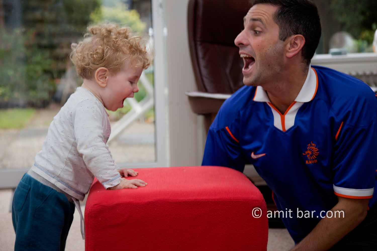Roaring: A baby and his uncle having fun