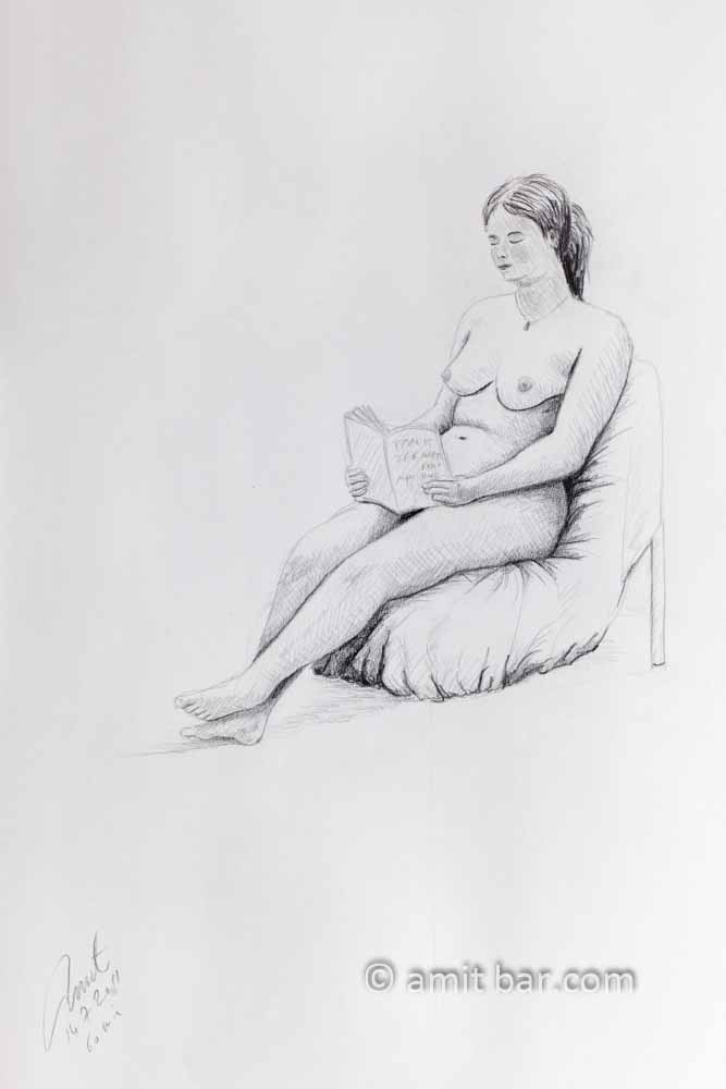 Seated nude reading a book. Pencil drawing
