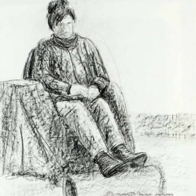 Seated woman with legs on roll