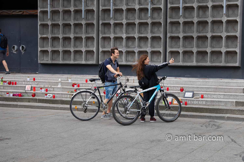 Terror selfie: Two bikers making a selfie in front of memorial monument