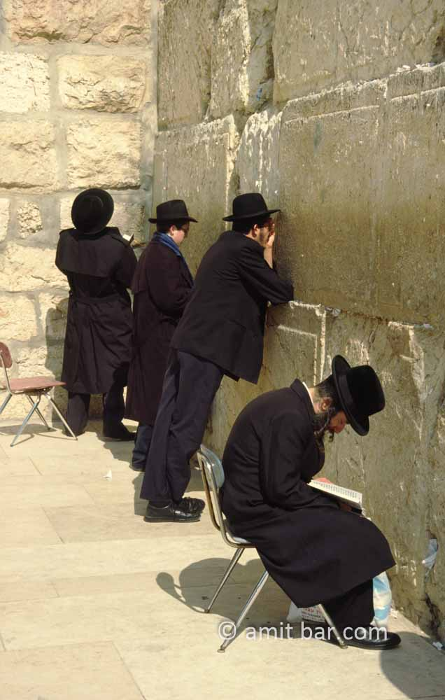 The Wailing Wall: Four religious Jews are praying at the holy wall in Jerusalem