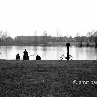 Willows, bikes, fishermen and reflections