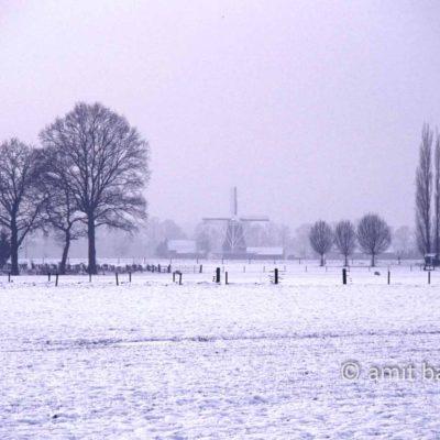 Windmill in snowy landscape